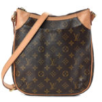 This stylish messenger bag is crafted of signature Louis Vuitton monogram coated canvas